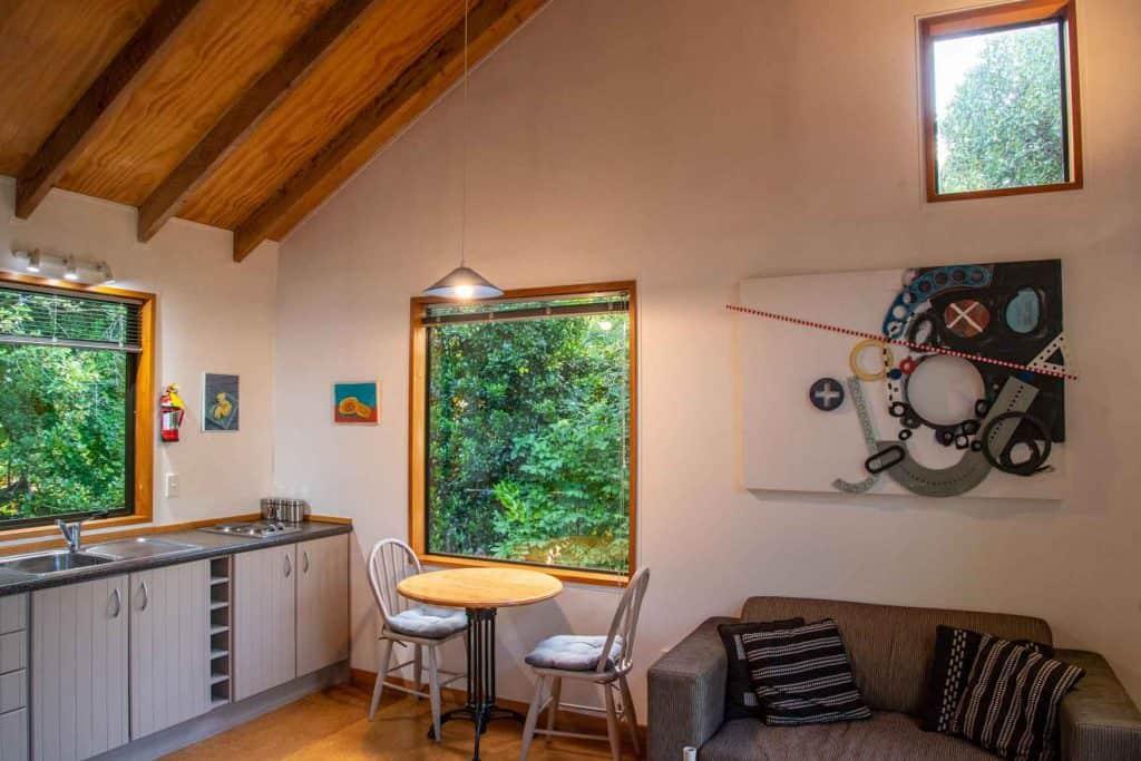 Living room area of Bellbird Cottage accommodation in Dunedin