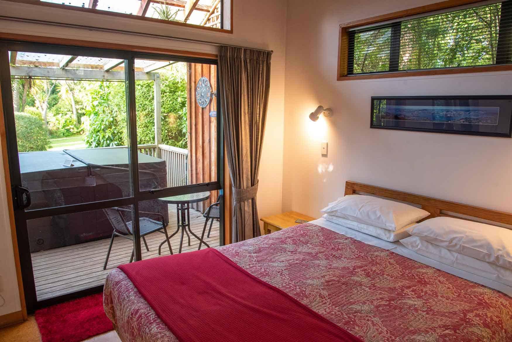 Bedroom of Bellbird Cottage accommodation in Dunedin