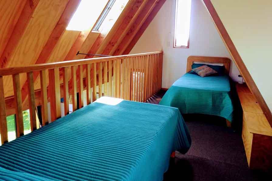 Single beds on mezzanine floor in Fantail cottage accommodation in Dunedin